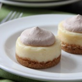 Mini Baileys Cheesecakes with Chocolate Whipped Cream Recipe - bakedbyrachel.com