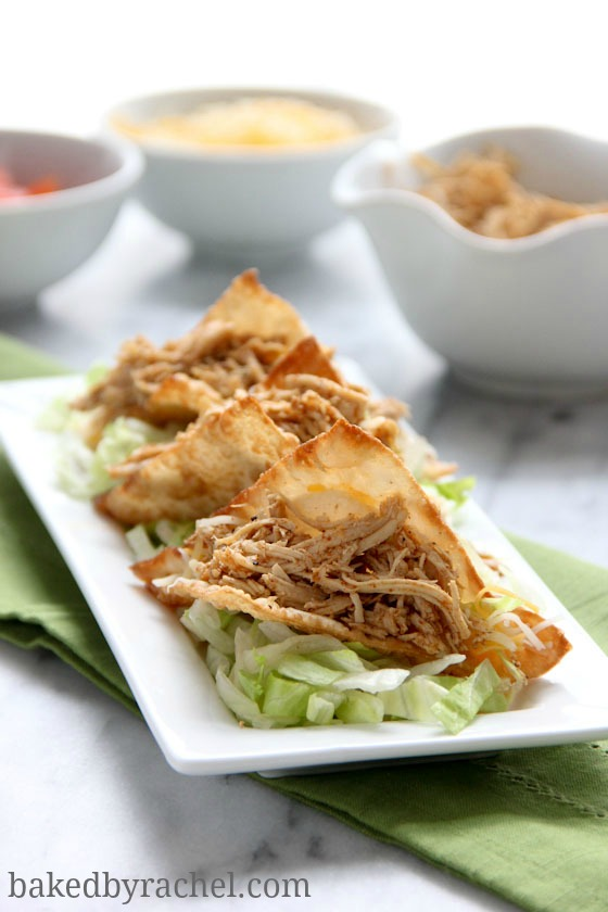 Spicy Slow Cooker Chicken Wonton Tacos Recipe from bakedbyrachel.com