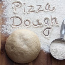 Easy Whole Wheat Pizza Dough Recipe from bakedbyrachel.com