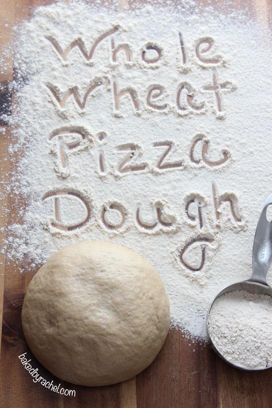 Easy Whole Wheat Pizza Dough Recipe from bakedbyrachel.com