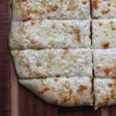 Cheesy Garlic Pizza Bread Sticks Recipe from bakedbyrachel.com