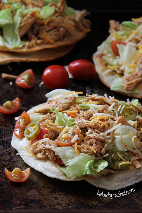 Loaded seasoned chicken tacos on a puffy fried tortilla. Recipe by @bakedbyrachel