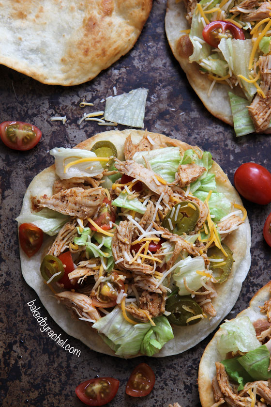 Loaded seasoned chicken tacos on a puffy fried tortilla. Recipe by @bakedbyrachel