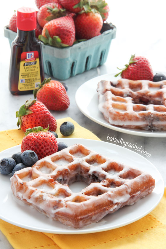 Deep fried berry waffles coated in a sweet lemon glaze. Recipe from @bakedbyrachel