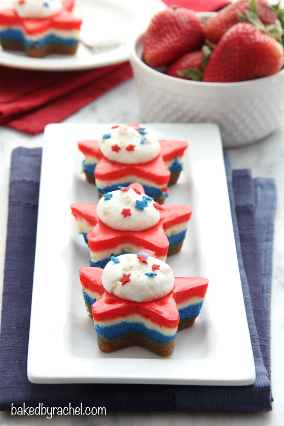 Mini red, white and blue layered star cheesecakes. A fun patriotic dessert recipe from @bakedbyrachel, perfect for the 4th of July!