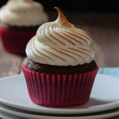 Chocolate s'more cupcakes with homemade marshmallow frosting. Recipe from @bakedbyrachel