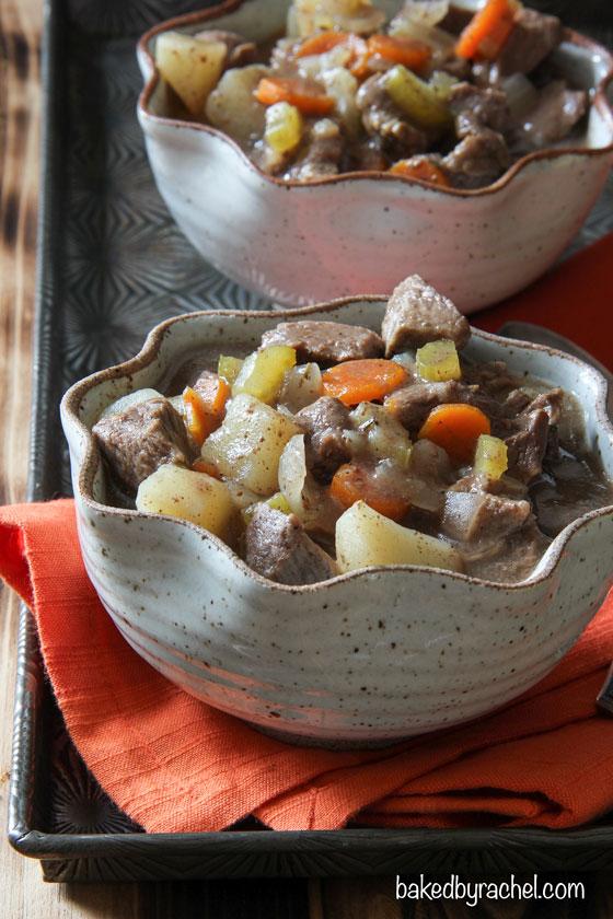 Slow cooker apple cider beef stew recipe from @bakedbyrachel A seasonal twist on a classic dish!