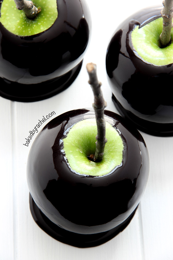 Spooky Black Caramel Apples | Baked by Rachel