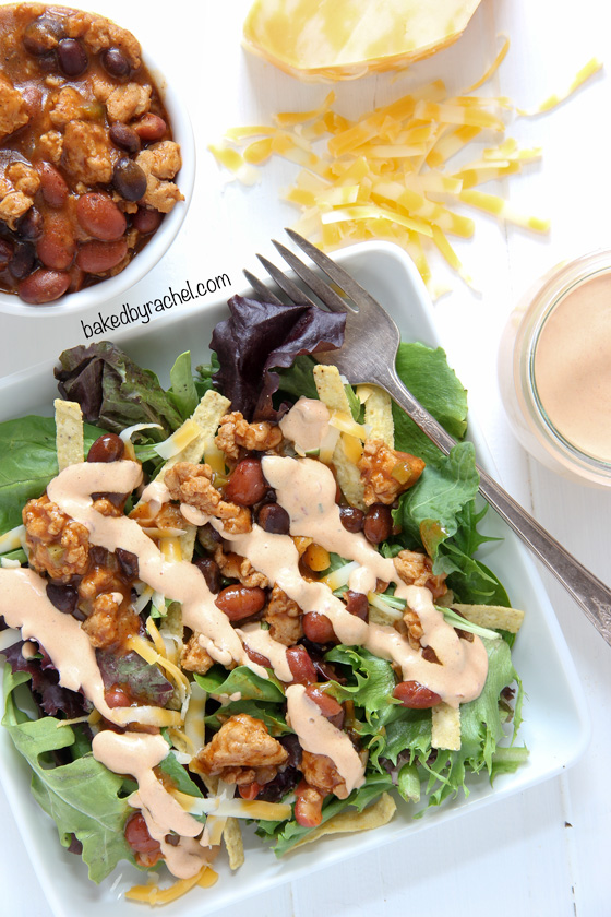 Southwestern chili taco salad with homemade chipotle ranch dressing. Recipe from @bakedbyrachel