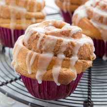 Tender cinnamon roll muffins with vanilla glaze recipe from @bakedbyrachel. A perfect addition to breakfast or brunch!