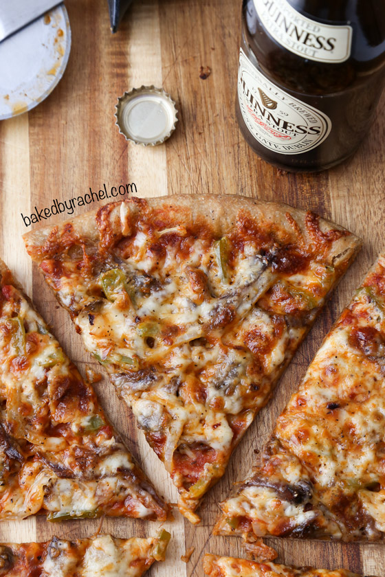 Thin crust Guinness pizza with beef, mushrooms and peppers. Recipe from @bakedbyrachel