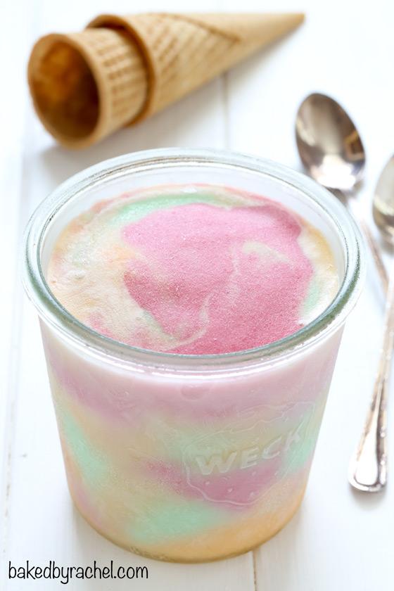 Easy homemade rainbow sherbet, bursting with raspberry, orange and lime flavors! Recipe from @bakedbyrachel