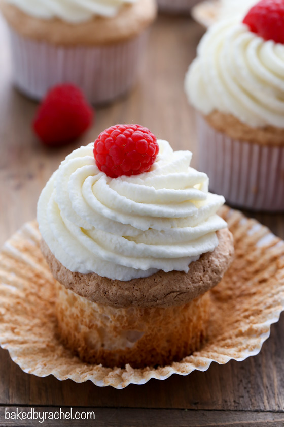 Moist angel food cupcakes with stabilized whipped cream frosting and fresh berries. Recipe from @bakedbyrachel