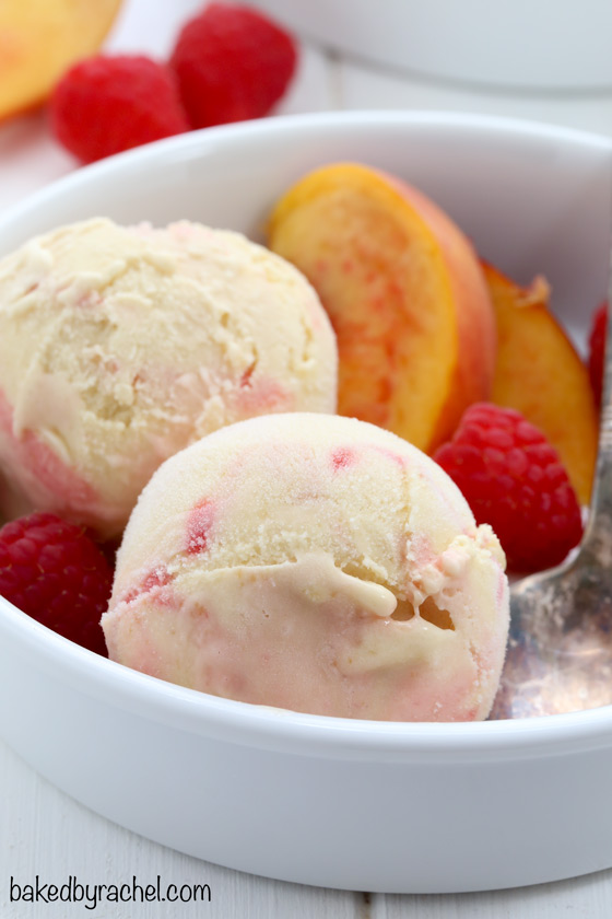 Creamy peach ice cream with raspberry swirls. Recipe from @bakedbyrachel