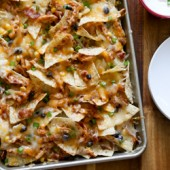 Easy crowd pleasing barbecue chicken nachos recipe from @bakedbyrachel