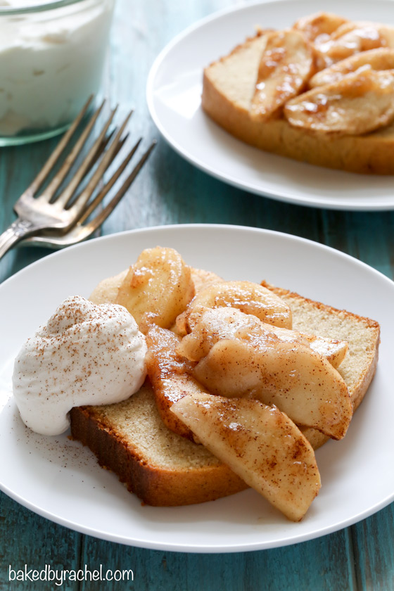 Cinnamon yogurt pound cake served with cinnamon apples and brown sugar whipped cream. Recipe from @bakedbyrachel