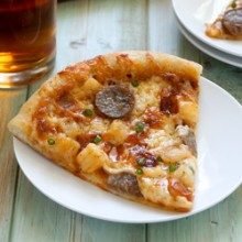 Bratwurst and potato pizza with beer crust! Recipe from @bakedbyrachel