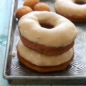 Homemade fried pumpkin yeast donuts with a sweet brown sugar maple glaze recipe from @bakedbyrachel