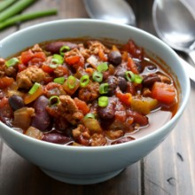 Sweet and spicy hearty slow cooker turkey and two bean chili recipe from @bakedbyrachel