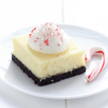 Creamy white chocolate peppermint cheesecake bars recipe from @bakedbyrachel