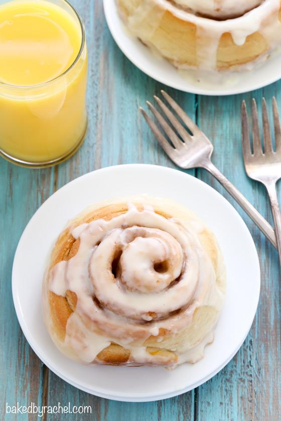 Giant fluffy orange cinnamon sweet rolls recipe from @bakedbyrachel (Egg Free)