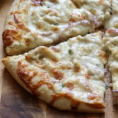 Thin crust three cheese chicken pizza with garlic white sauce recipe from @bakedbyrachel