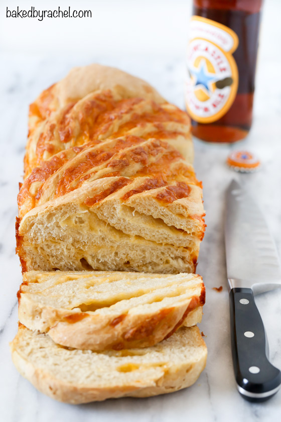 Soft and airy homemade braided cheddar beer bread recipe from @bakedbyrachel