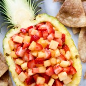 Strawberry pineapple salsa with cinnamon tortilla chips. Recipe from @bakedbyrachel A family friendly snack or appetizer!
