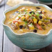 Flavor packed slow cooker cheesy beef nacho soup recipe from @bakedbyrachel