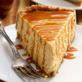 Spiced pumpkin cheesecake with homemade caramel sauce recipe from @bakedbyrachel A classic Fall dessert!