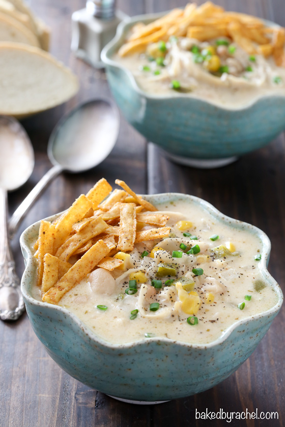 Slow cooker creamy white chicken chili with cheddar cheese recipe from @bakedbyrachel