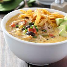 Cheesy slow cooker chicken fajita soup recipe from @bakedbyrachel