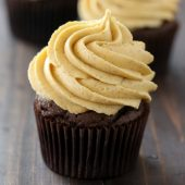 Moist homemade chocolate pumpkin cupcakes with creamy pumpkin buttercream frosting recipe from @bakedbyrachel