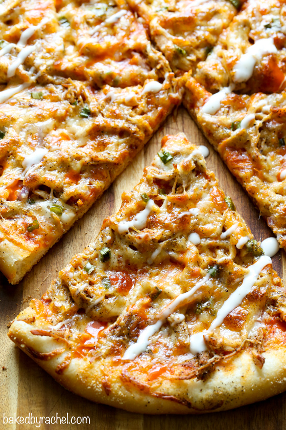 Thin crust four cheese spicy buffalo chicken pizza recipe from @bakedbyrachel A fun and super flavorful addition to any pizza night or game day menu!