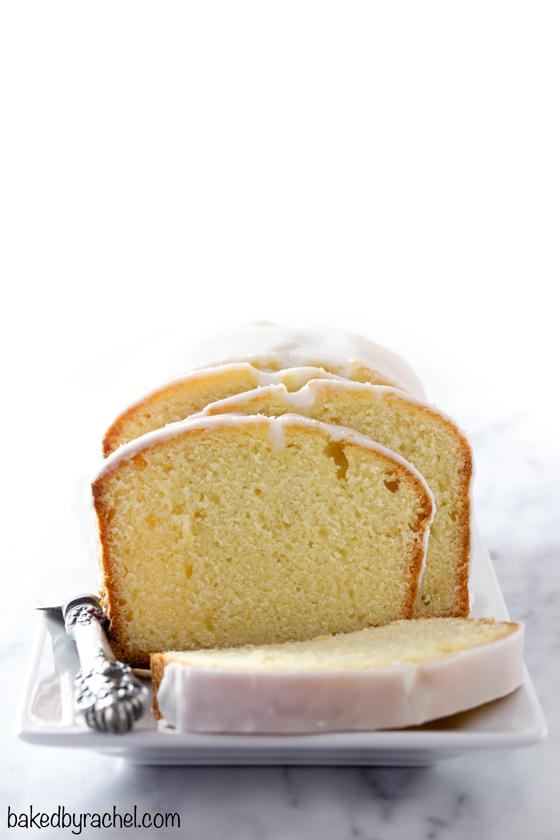 Moist homemade lemon pound cake loaf with a tart lemon glaze recipe from @bakedbyrachel. This simple treat is bursting with flavor! Enjoy for breakfast, brunch or dessert!